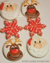 Adorable Santa and Rudolf cookies by Cookievonster, she makes it look so easy.