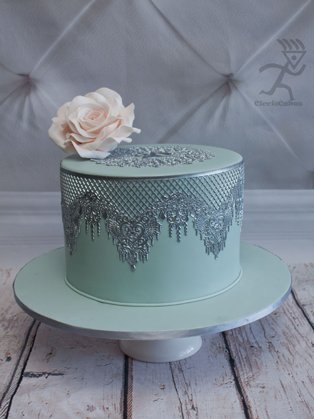 Edible Silver lace on a double barreled 9″ paleblue cake with ...: edibleartistsnetwork.com/gallery/birthday-cakes/silver-lace-cake